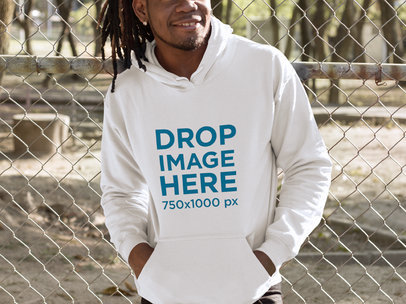 Smiling Black Man With Locs Leaning on a Fence Hoodie Mockup a8762