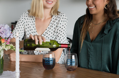 Stemless Wine Glass Mockup Featuring Two Friends At a Table 27954