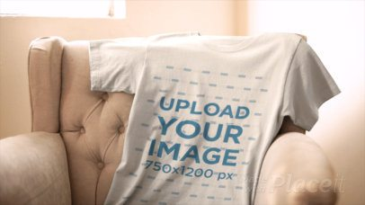 Video of a T-Shirt Lying on an Armchair Next to a Window 13065