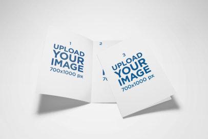Mockup of Two A5 Bi-Fold Brochures on a Plain Surface 35-el