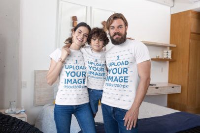 T-Shirt Mockup Featuring a Family of Three Posing in The Bedroom 28062a
