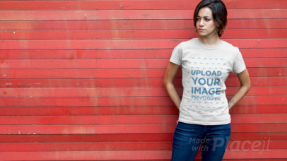 T-Shirt Video Featuring a Young Woman in Front of a Red Wooden Wall 12150