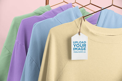 Brand Tag Mockup Featuring a Rack of Crewneck Sweatshirts 27633