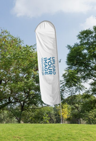 Mockup of a Flag Banner Standing on a Lawn by Some Trees 28023