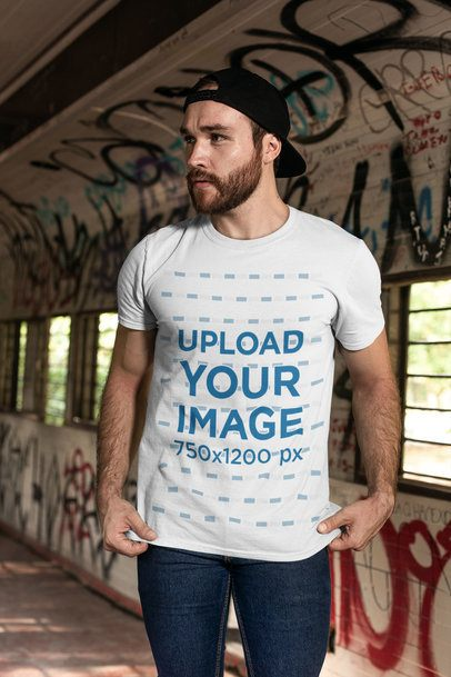 T-Shirt Mockup Featuring a Bearded Man with a Cap by a Graffiti Wall 28194