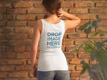 Girl Facing a Bricks Wall Wearing a Tank Top Mockup from Behind 9043b