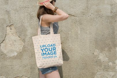 Tote Bag Mockup Featuring a Woman Walking by an Old Wall 102-el