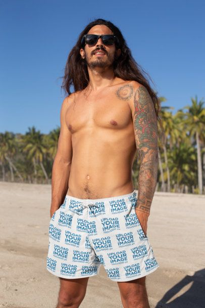 Swim Trunks Mockup Featuring a Tattooed Man With Sunglasses 28369