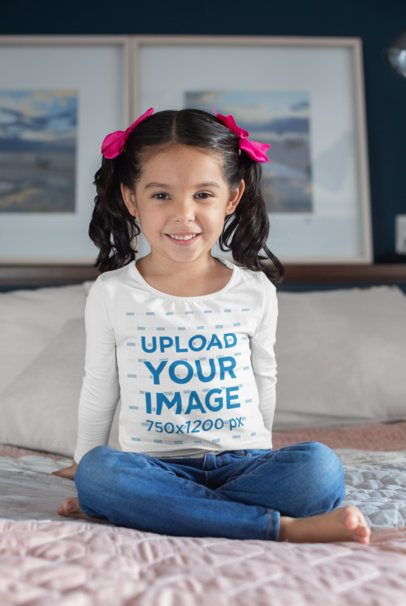 Long Sleeve Shirt Mockup Featuring a Little Kid Sitting over a Bed 28080