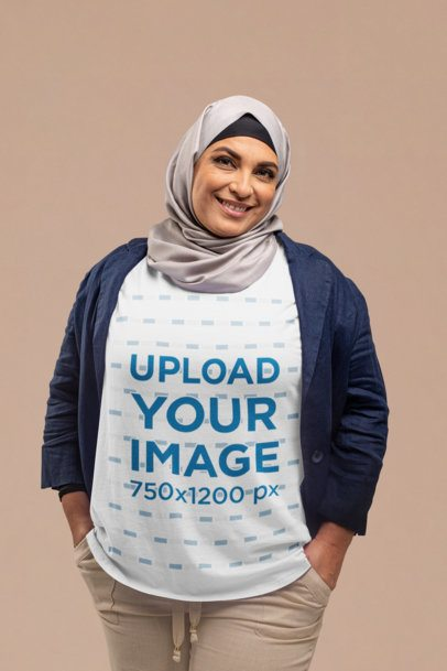 T-Shirt Mockup of a Woman Wearing a Hijab and Looking at the Camera at a Studio 28280