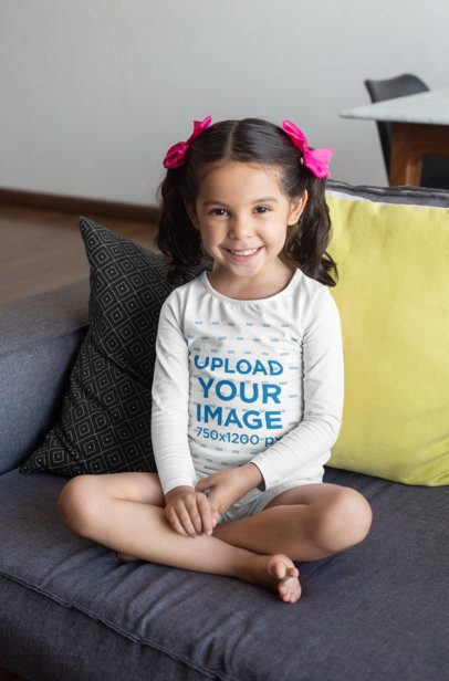 Long Sleeve T-Shirt Mockup Featuring a Girl Sitting on a Couch 28091