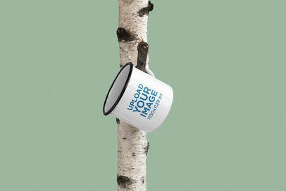 Mockup of a 12 oz Enamel Mug Hanging on a Tree 182-el
