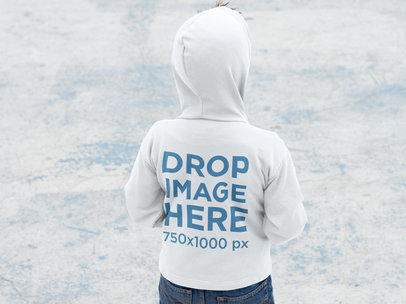 Back of a Small Kid Wearing a Pullover Hoodie Mockup During Winter a9120b
