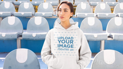 Hoodie Video of a Woman Sitting at a Stadium 13208