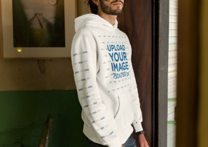 Mockup Featuring a Dark-Haired Man Wearing a Pullover Hoodie With Customizable Sleeves 28307
