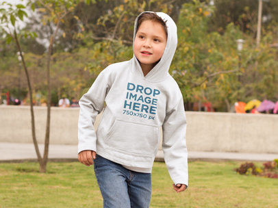 Young Kid at a Park Running Around Hoodie Mockup f9121