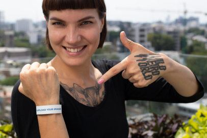 Mockup of a Woman Showing off Her Paper Wristband 28222
