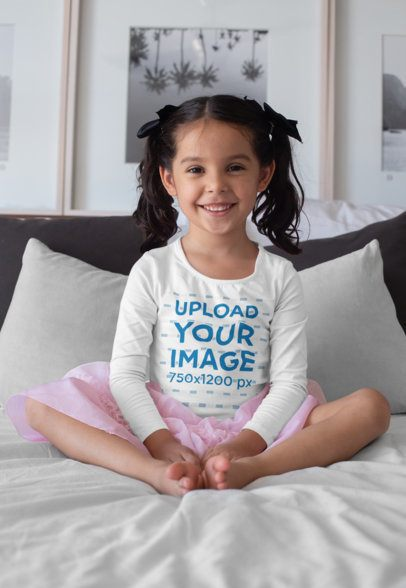 Mockup of a Girl Wearing a Long Sleeve Tee Sitting in Bed 28106