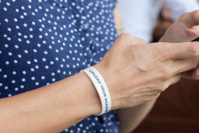 Mockup of a Silicone Wristband on a Man's Wrist  28225