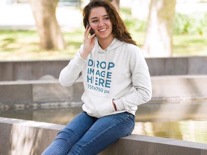 Girl at School Making a Phone Call Hoodie Mockup a9184