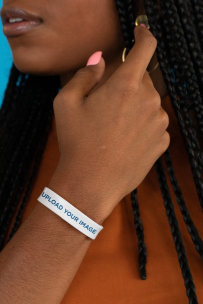 Mockup Featuring a Long-Haired Woman Wearing a Silicone Wristband 28232