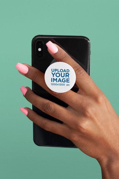 Mockup of a Hand Holding a Phone with a Phone Grip on a Plain Background 28169