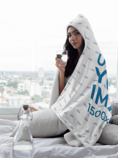 Hooded Blanket Mockup Featuring a Woman Holding a Glass of Water 28142