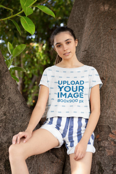 Crop Top T-Shirt Mockup Featuring a Woman Leaning Back on a Tree 28575