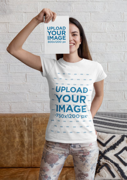 Mockup of a Woman Wearing a T-Shirt While Covering Her Face with a Book 28486