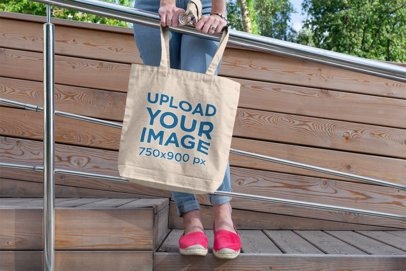 Tote Bag Mockup of a Woman Leaning on a Metal Handrail 194-el