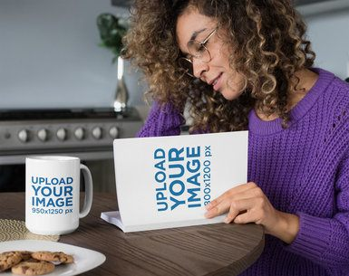 Mug and Book Mockup Featuring a Woman Reading in the Kitchen 28470