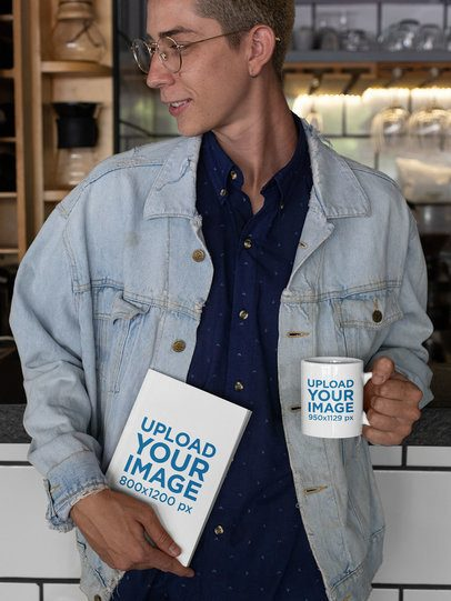 Mockup of a Hipster Man Holding a Coffee Mug and a Book 28464