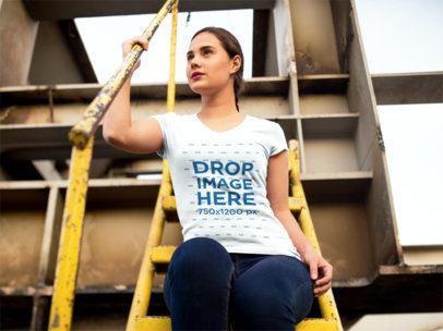 Woman Sitting on a Metallic Staircase T-Shirt Mockup a9091