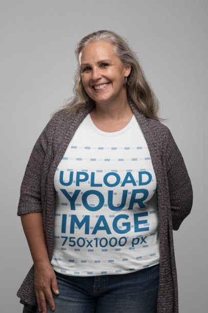 T-Shirt Mockup Featuring a Smiling Senior Woman in a Studio 28446