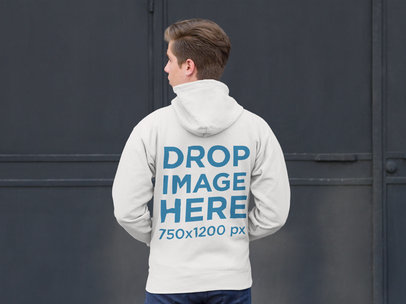 Back of Zip Up Hoodie Mockup Featuring a Blonde Man Standing in Front of a Gray Wall a9066b