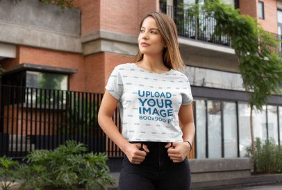Sublimated Crop Top Mockup Featuring a Young Woman on a Street 28553