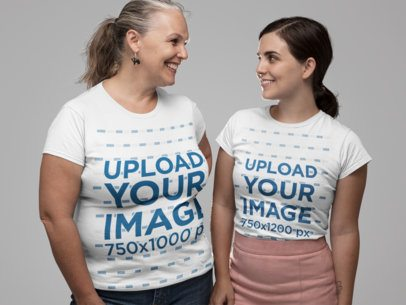 Mockup of Mother and Daughter Wearing a T-Shirt and Looking at Each Other 28505