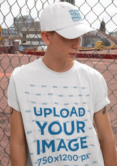 T-Shirt Mockup of a Man with an Ear Piercing Wearing a Dad Hat 28584