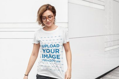 Tee Mockup Featuring a Short-Haired Woman with Glasses Against a White Wall 415-el