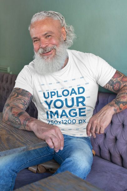 T-Shirt Mockup Featuring a Tattooed Senior Man Smiling 28418