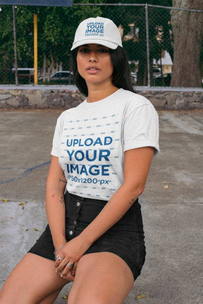 T-Shirt Mockup of a Young Woman Wearing a Dad Hat in an Urban Scenario 28597