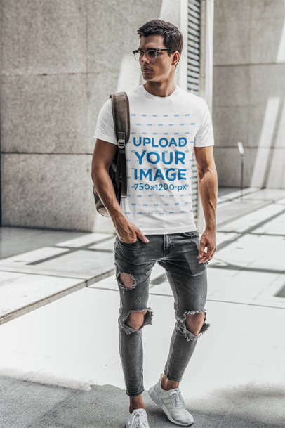 T-Shirt Mockup of a Man with Glasses Carrying a Backpack on His Shoulder 421-el