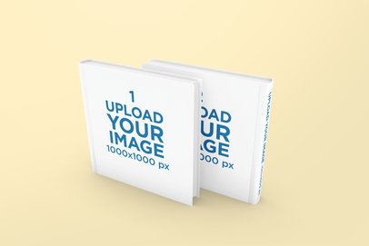 Mockup Featuring Two Hardcover Square Books Standing Against a Solid Color Backdrop 297-el