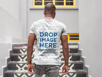 Back of a Man Walking Up a Mosaic Stairway Wearing a T-Shirt Mockup a9355b