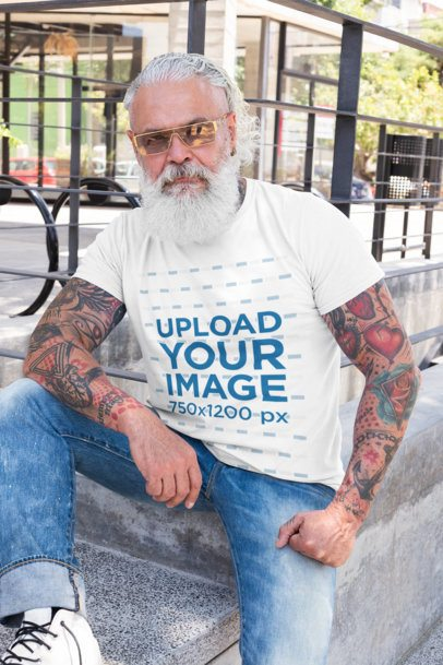 T-Shirt Mockup of a Senior Tattooed Man with Sunglasses 28424
