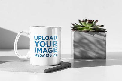 11 oz Coffee Mug Mockup Featuring a Plant Pot Having a Sunbath 394-el