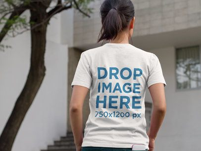Mockup of a Girl from the Back Wearing a Tshirt on the Street a9442b