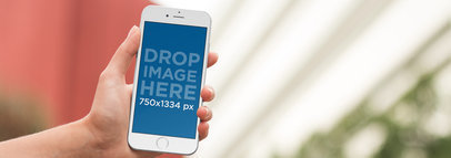 iPhone Mockup Being Used in a Backyard a9368