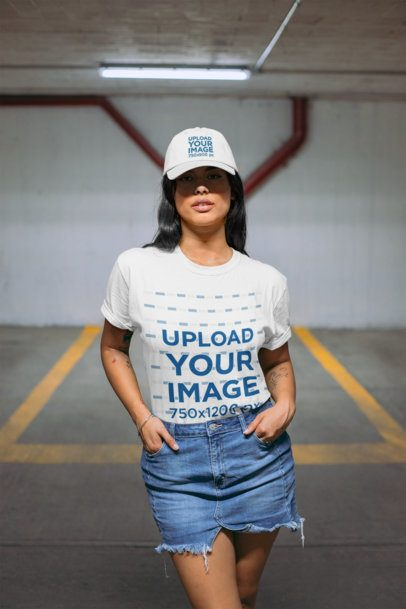 T-Shirt Mockup Featuring a Woman with a Hat on a Parking Garage 28609