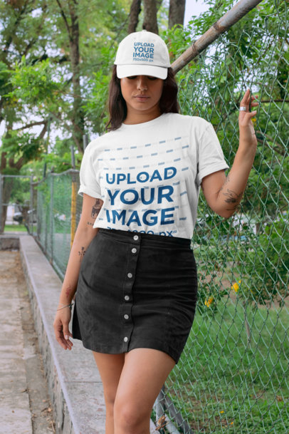 Mockup of a Tattooed Woman Wearing a Crew Neck T-Shirt and a Dad Hat 28603